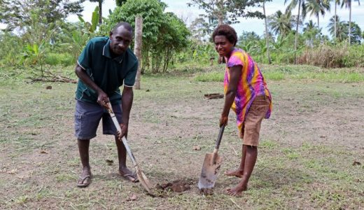 Bougainville cocoa farmers Felix and Marcia turn the first sod in Torpanos village, Tinputz District, in preparation for construction of the new solar combination dryer/ Photo courtesy – Australian High Commision, PNG.