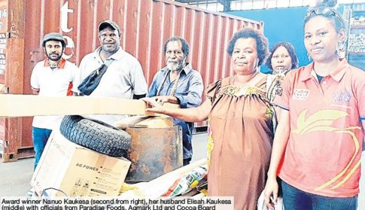 A WOMAN from Guadu village in Salamaua, Morobe, who won the best woman farmer at the Kumul blo Morobe Cocoa of Excellence Show in July received her prizes on Friday.